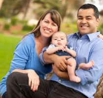 stockfresh_id600770_happy-mixed-race-family-posing-for-a-portrait_sizexs_2174d6